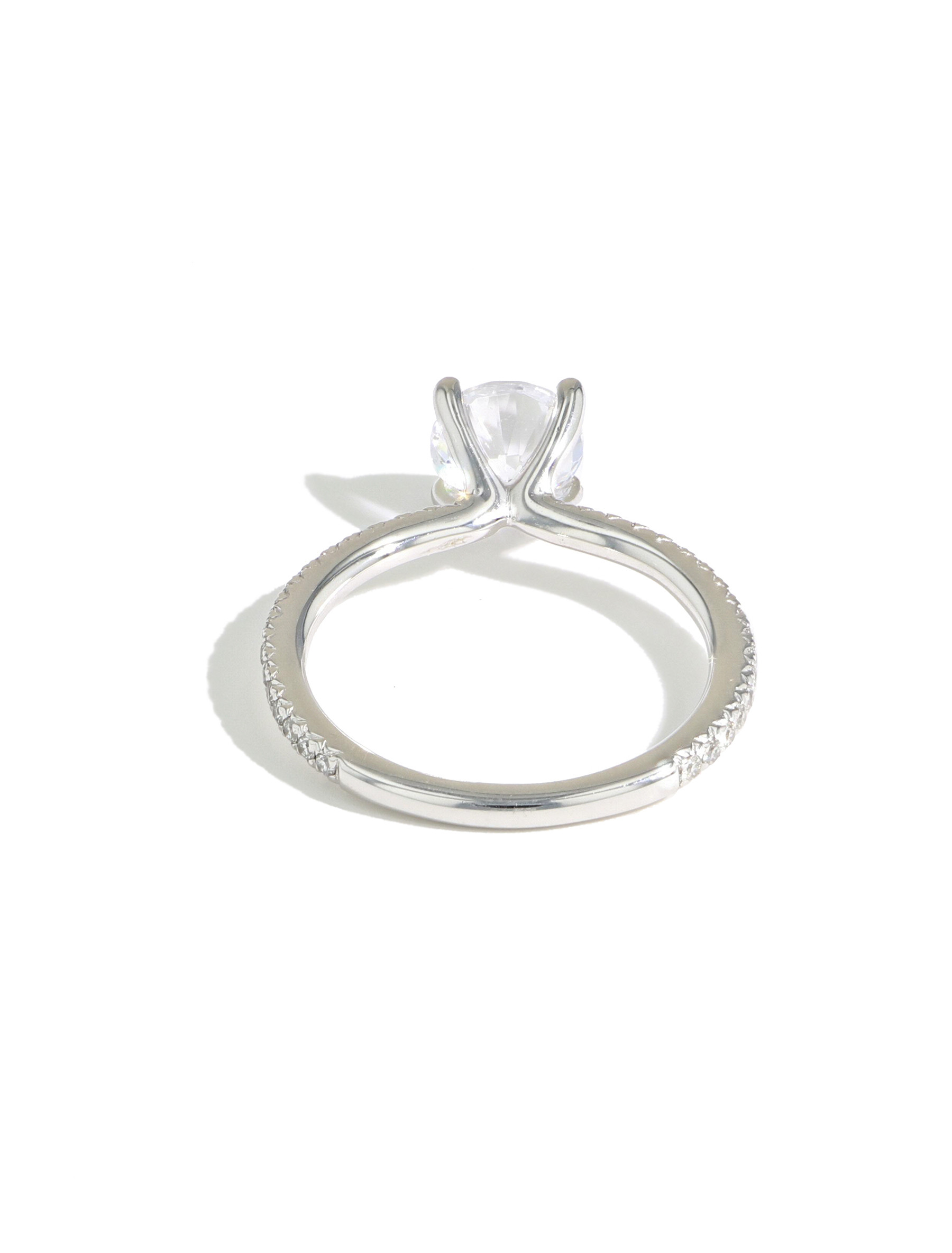 The Round Solitaire Pave Engagement Ring in Platinum back view