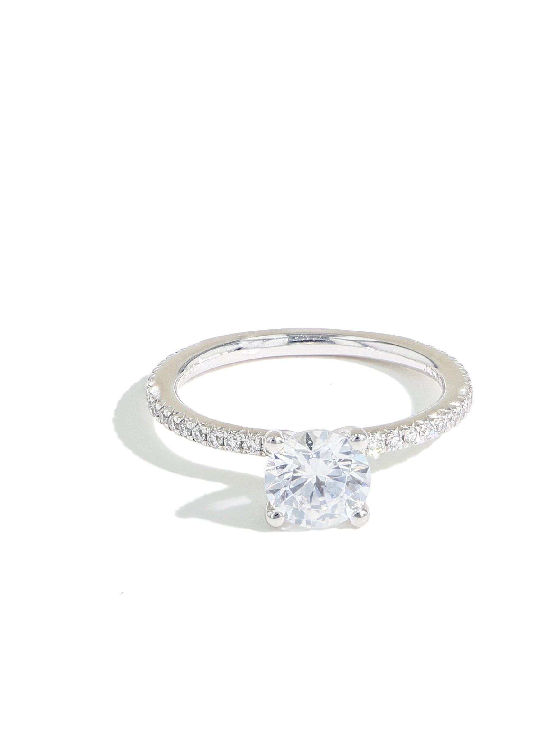 The Round Solitaire Pave Engagement Ring in Platinum front view