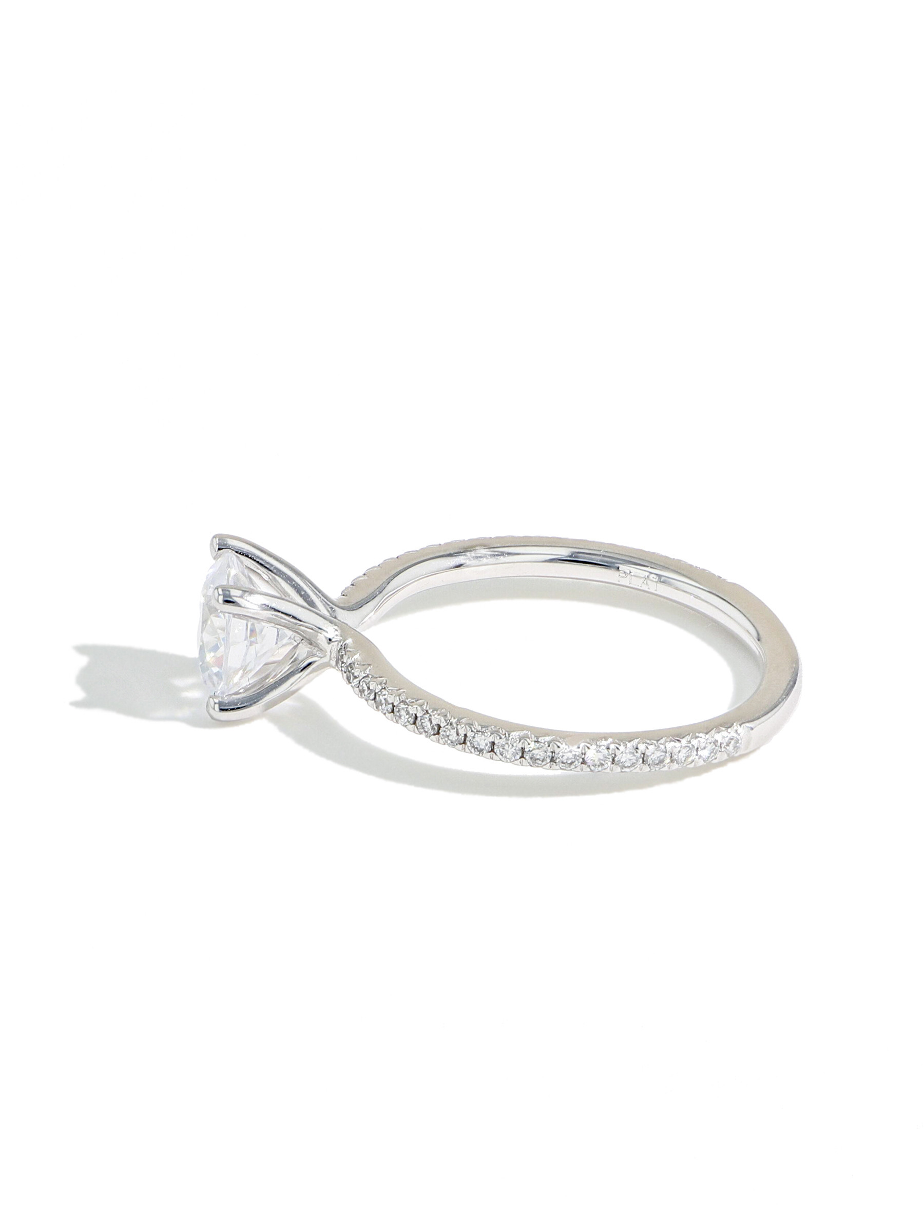 The Round Solitaire Pave Engagement Ring in Platinum side view