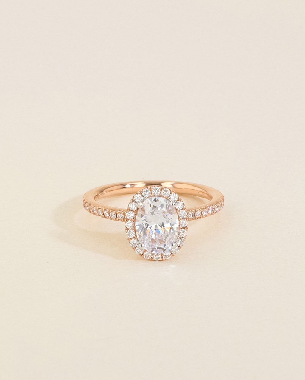 Halo Oval Engagement Ring With Diamond Pave Band In Rose Gold