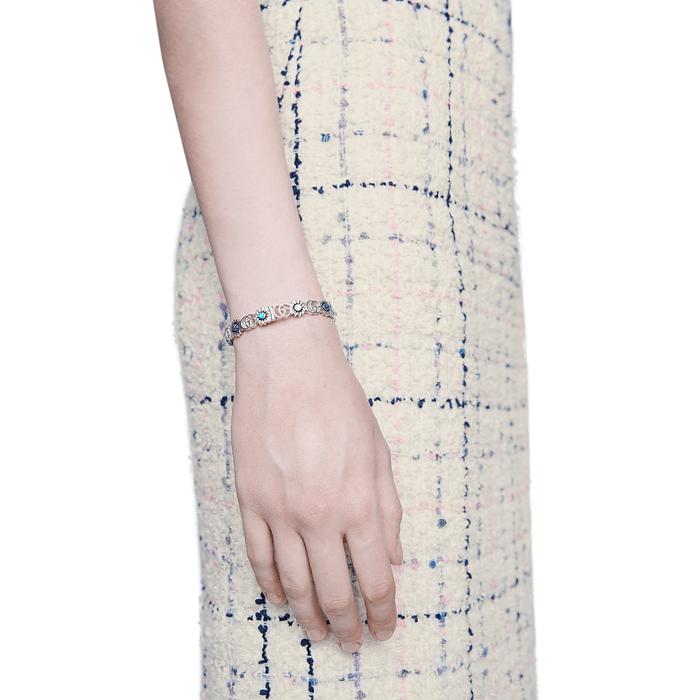 Gucci Marmont Sterling Silver Flower Bangle Bracelet With Gemstones on model
