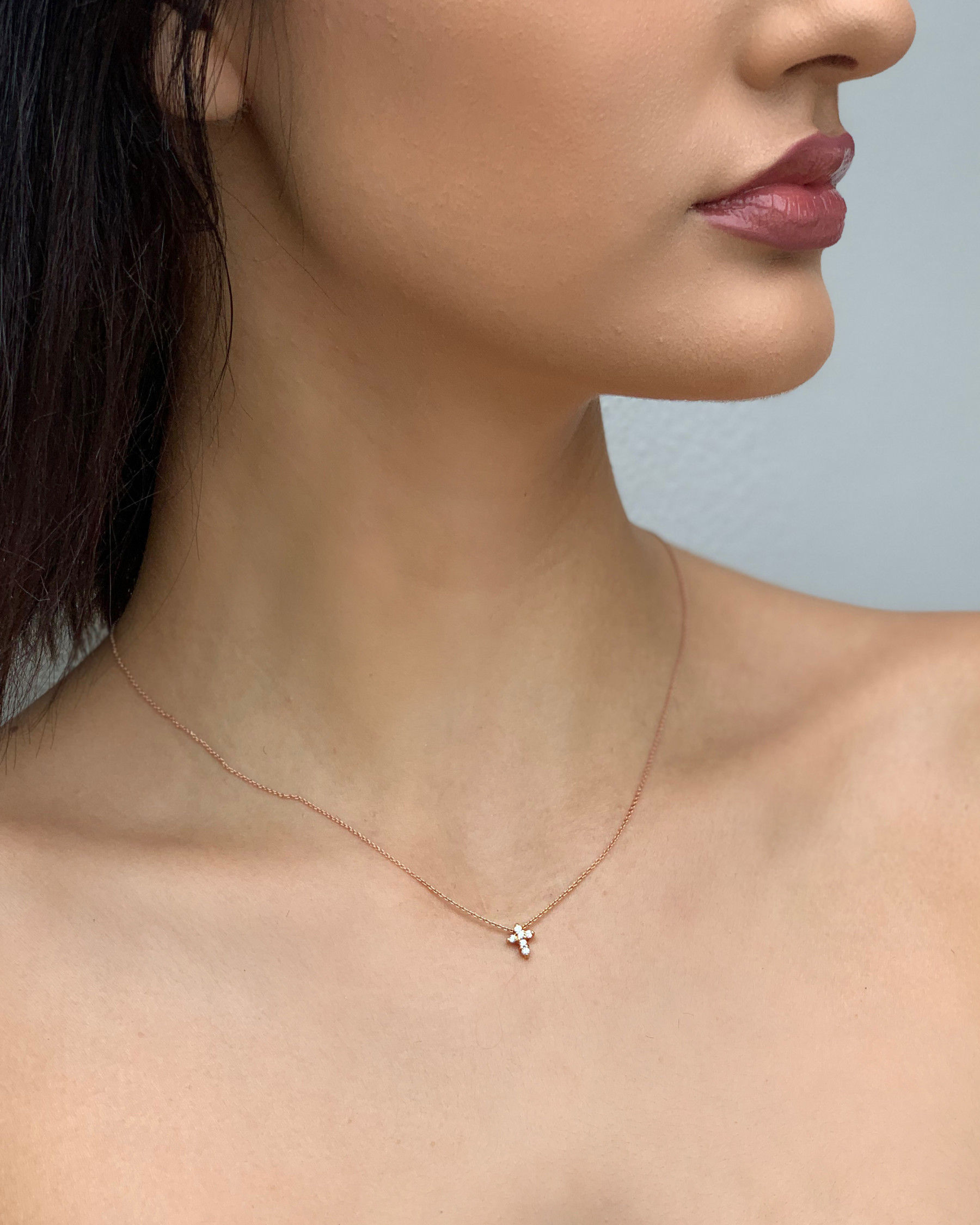 Roberto Coin Baby Cross Necklace in 18k Rose Gold on Model