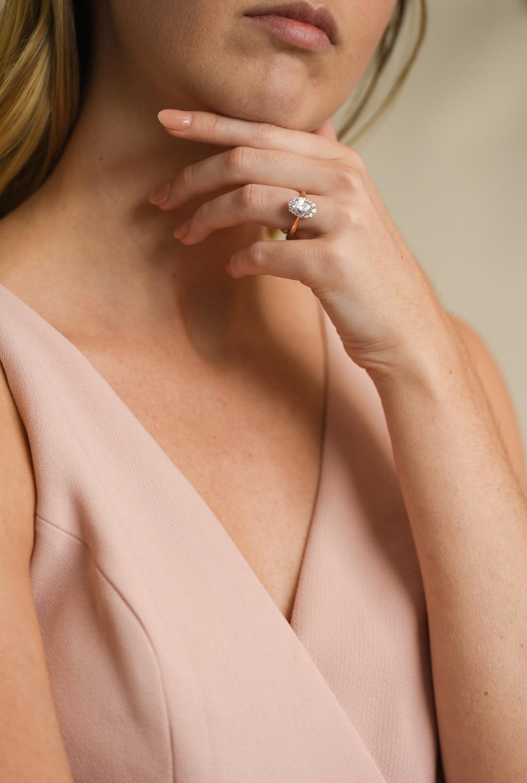 Vintage Diamond Halo Engagement Ring on model
